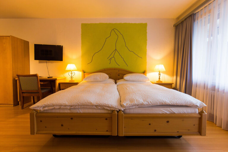 haus_theodul_zermatt_budget_apartments_302_bedroom_012